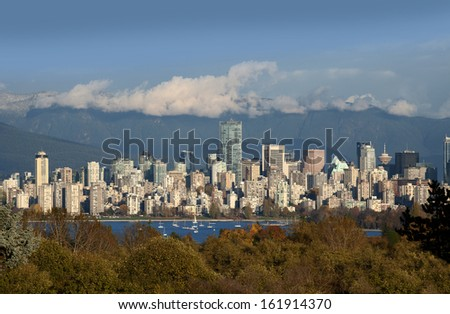 Vancouver - skyline with Coast Mountains and English Bay