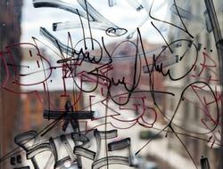 Vandal graffiti on the window of a house