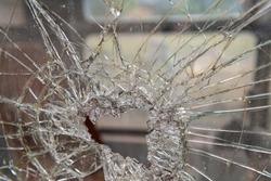 Vandalism, destroyed glass on a construction machine