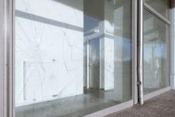 vandalized broken windows