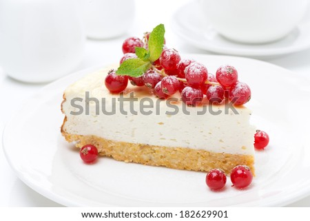 vanilla cheesecake with fresh red currants, close-up - stock photo
