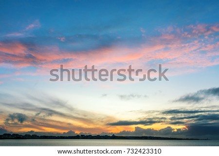 Vanilla clouds, sunset over the ocean in Iceland. - Shutterstock ID 732423310