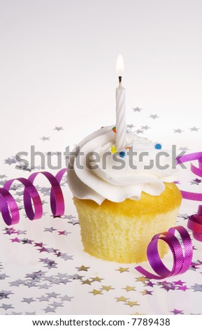 Vanilla Cupcake with White Candle.