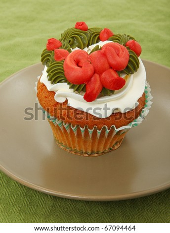 Vanilla Cupcake With Wreath On Frosting On Plate