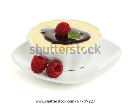 vanilla custard with chocolate topping and raspberries isolated on white