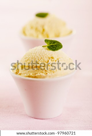 Vanilla ice cream in a little bowls on pink background