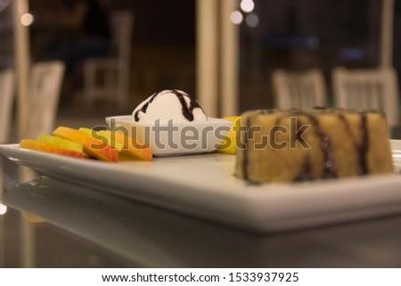Vanilla ice cream with dessert and fruits (İrmik Tatlisi ve Dondurma)  Stok fotoğraf ©