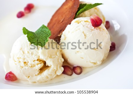 Vanilla ice cream with pomegranate seeds and mint