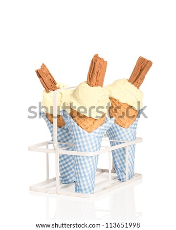 Vanilla ice creams with chocolate flakes on white background