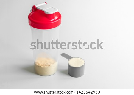 Vanilla whey protein scoop. Sports nutrition. whey protein shaker on white backgrouns.