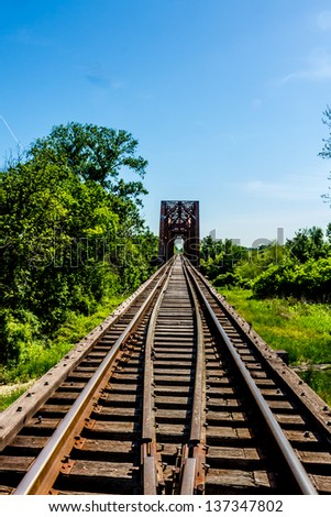Vanishing Point View of an Old Railroad Trestle with an Old Iconic Iron Truss Bridge Over the Brazos River, Texas.