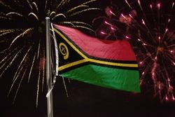 Vanuatu flag blowing in the wind at night