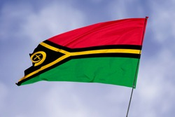 Vanuatu flag isolated on sky background. National symbol of Vanuatu. Close up waving flag with clipping path.