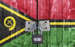 Vanuatu flag on door with padlock