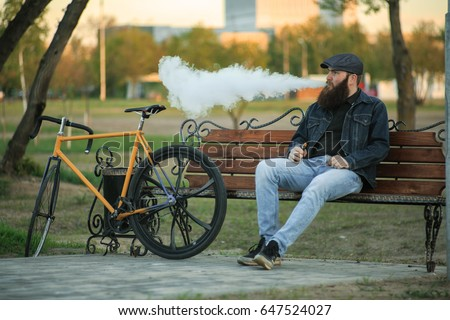 vape in life. young man with...