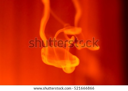 Vape smoke over red background