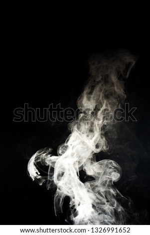 Vape steam spread with spray boiling liquid. Stock photo isolated on black background. Vape culture outreach. Conceptual image.