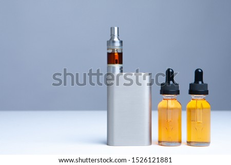 Vaping. Vape smoke. Online vape shop. Internet shop for the vaper. Order accessories for vaping online. Order an electronic cigarette. E-Sigs. e-cig. Juice for vape. Buy juices for vaping. stock photo