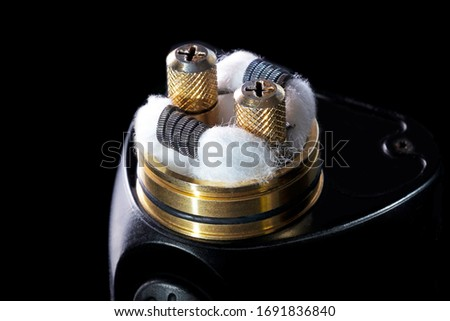 Photo of  Vapor Rda recoil and wicking before use isolated on black close up