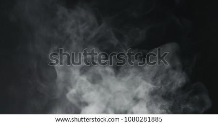 vapor steam rising over black background