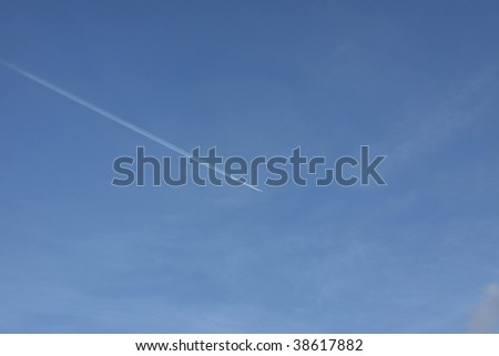 Vapor trail from a commercial jetliner.