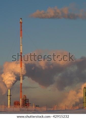 vapors flood the blue Alberta sky from a petrochemical refinery near Edmonton, Alberta, Canada