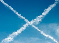 Vapour trails from aircraft forming an cross