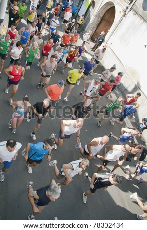"VAPRIO D'AGOGNA, ITALY - MAY 29: A  group of runners participate  in the ""Marcia Nazionale Tricolore, Gamba d'Oro"" walking race on May 29 2011 in Vaprio d'Agogna ,Italy"