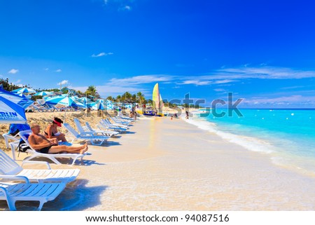 VARADERO,CUBA-JANUARY 28:Tourists enjoying the beach January 28, 2012 in Varadero, Cuba. One of the largest resort areas in the Caribbean, Varadero receives more than 3.5 million visitors per year