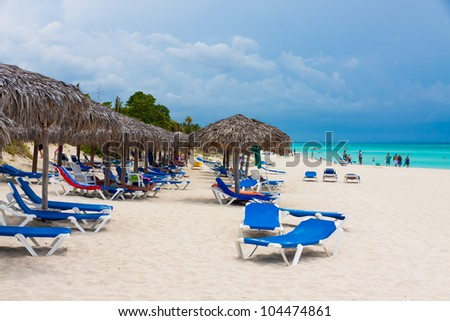 VARADERO,CUBA-MAY 26:Group of  tourists relaxing at the beach May 26,2012 in Varadero.With over a million visitors per year,Varadero is the main destination for the growing cuban tourism industry - stock photo