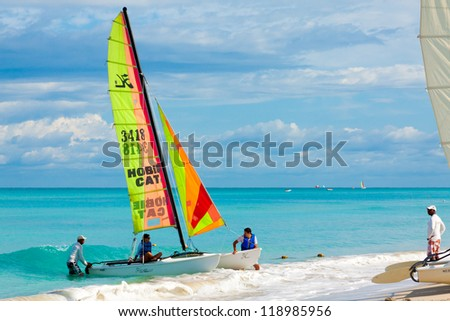 VARADERO,CUBA-NOVEMBER 3:Tourists sailing on a catamaran November 3,2012 in Varadero.With over a million visitors per year,Varadero is the destination of more than 40% of tourists visiting the island