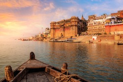 Varanasi ancient city architecture at sunset as viewed from a boat on river Ganges.