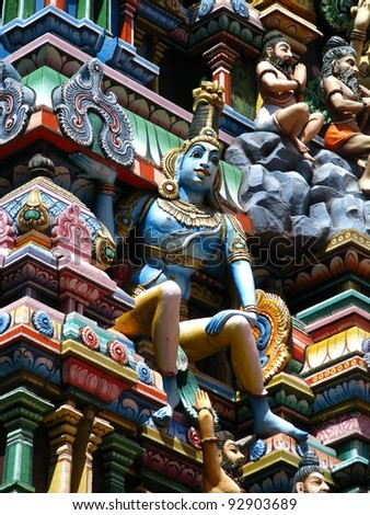 Varanasi (Benares), India: polychromed figures of hinduist gods on the roof of a temple.