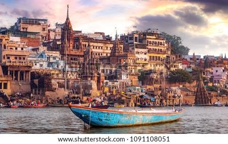 Varanasi city with ancient architecture. View of the holy Manikarnika ghat at Varanasi India at sunset.