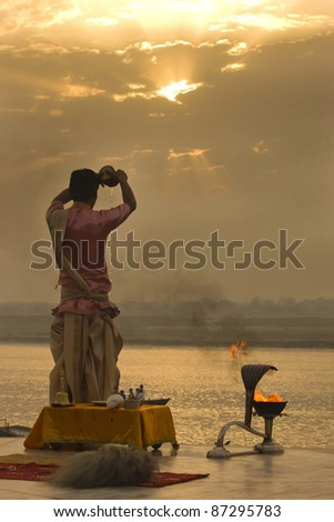 VARANASI, INDIA - APRIL 1: An Unidentified Hindu Brahman monk meditates on the ghat stairs of holy Ganges river on the auspicious festival on April 1, 2011 at Varanasi,Uttar Pradesh, India