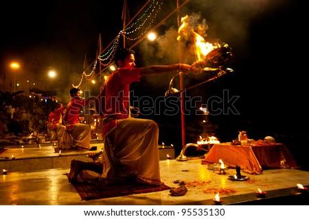 VARANASI, INDIA - APRIL 23: An unidentified Hindu priest performs religious Ganga Aarti ritual (fire puja) at Dashashwamedh Ghat on April 23, 2011 in Varanasi, Uttar Pradesh, Central India