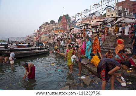 VARANASI, INDIA-APRIL 18: Crowding of local Indian people live their morning life on Ganga riverbank. The most holy river of India and Hindu culture on April 18, 2010 in Varanasi, India.