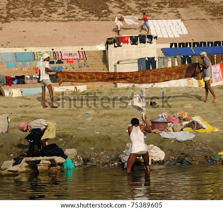 VARANASI, INDIA - APRIL 2: Unidentified Dhobis or washermen wash and dry linen on April 2, 2011 at Dhobighat, Varanasi, Uttar Pradesh, Central India. The washing industry is very popular in Varanasi.