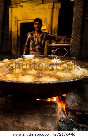 VARANASI, INDIA - FEBRUARY 08, 2015: A local food shop in the backstreets of Varanasi, India.