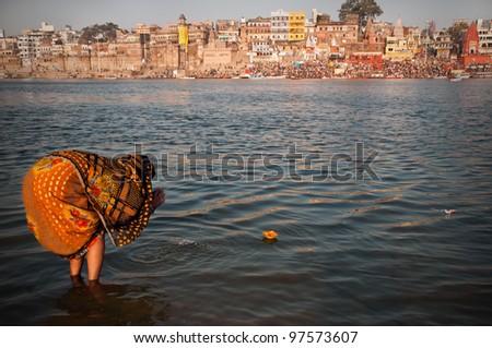 VARANASI, INDIA - FEBRUARY 20: An Unidentified pilgrim offers prayer to holy Ganges river on Maha Shivaratri festival on February 20, 2012 at Varanasi, Uttar Pradesh, India.
