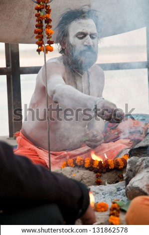 VARANASI, INDIA - MARCH 10: A hindu saint performs yagna prayer rituals of Lord Shiva on the auspicious Maha Shivaratri festival on March 10, 2013 at Varanasi, Uttar Pradesh, India.
