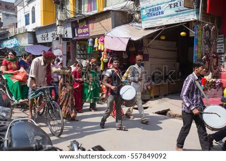 Varanasi, India 10 May 2015 - Pilgrims on the way to the bank of Ganga #557849092