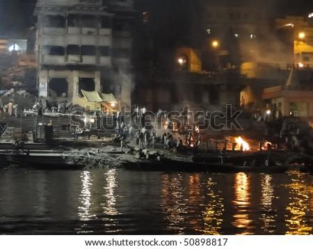 VARANASI, INDIA - NOV 5 -  Cremation flames of the burning ghats at Marnikanika Ghat on Nov 5, 2009,  in Varanasi, India.