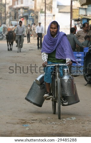 VARANASI, INDIA - NOVEMBER 27: A man delivers milk in unrefrigerated milk cans on November 27, 2008.  Unhygienic milk storage and distribution practices can lead to outbreaks of disease.