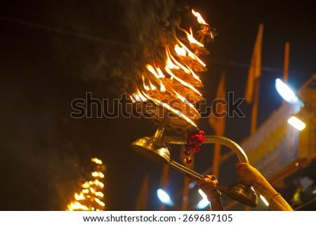 VARANASI, INDIA - NOVEMBER 25: An unidentified Hindu priest conducts religious Ganga Aarti ritual (fire puja) at Dashashwamedh Ghat on November 25, 2012 in Varanasi, Uttar Pradesh, Central India