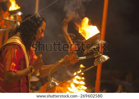 VARANASI, INDIA - November 25: An unidentified Hindu priest performs religious Ganga Aarti ritual (fire puja) at Dashashwamedh Ghat on November 25, 2012 in Varanasi, Uttar Pradesh, Central India
