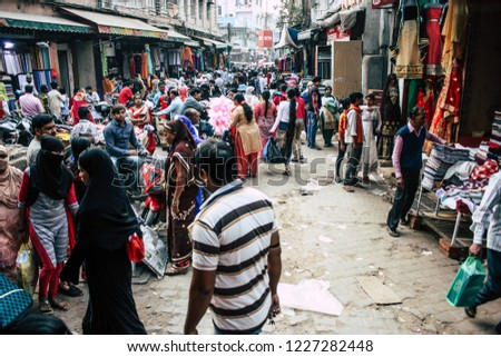 Varanasi India November 10, 2018 View of unknowns people walking in the bazaar at the Arabian district of the old city of Varanasi in the afternoon #1227282448