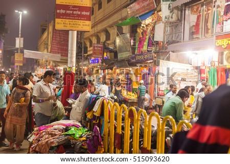 VARANASI, INDIA - 24 Oct 2016: Merchants and customers at the night market near Dasaswamedh Ghat on October 24, 2016 in Varanasi, India #515093620