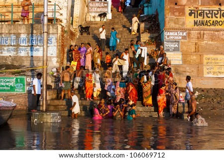 VARANASI, INDIA - SEPTEMBER 9 - Indian people on the steps of Manasarowar ghat wash themselves in the river Ganges on September 9, 2011 in Varanasi, India. They do this rite every day.