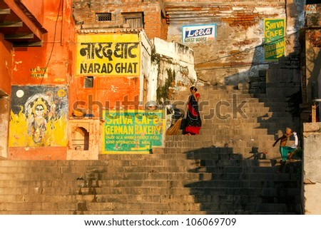 VARANASI, INDIA - SEPTEMBER 9 - Indian woman sweeps steps of Narad Ghat after ceremony of daily morning bathing in the Ganges River on September 9, 2011 in Varanasi, India.